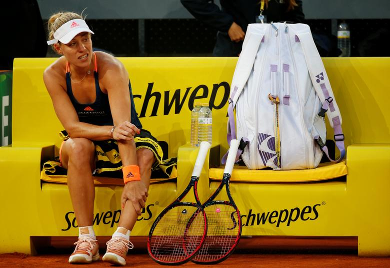 Tennis - WTA - Madrid Open - Angelique Kerber of Germany v Eugenie Bouchard of Canada - Madrid, Spain - 10/5/17 - Kerber holds her leg before retiring from the match. REUTERS/Susana Vera
