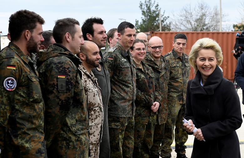FILE PHOTO: German Defence Minister Ursula von der Leyen chats with soldiers during a visit of the German Armed Forces Bundeswehr at the air base in Incirlik, Turkey, January 21, 2016. REUTERS/Tobias Schwarz/Pool/File Photo