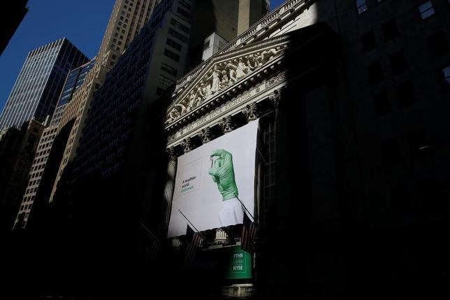 A banner for Patheon NV hangs to celebrate the company's IPO at the New York Stock Exchange (NYSE) in New York City, U.S., July 21, 2016.  REUTERS/Brendan McDermid