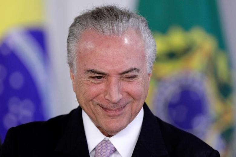 Brazil's President Michel Temer reacts during a signing ceremony of the New Decree of Port Regularization, at the Planalto Palace in Brasilia, Brazil May 10, 2017. REUTERS/Ueslei Marcelino