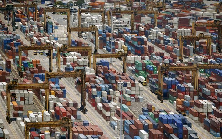 Containers are stacked up at PSA's Tanjong Pagar container terminal in Singapore July 24, 2015.    REUTERS/Edgar Su/File Photo/Files