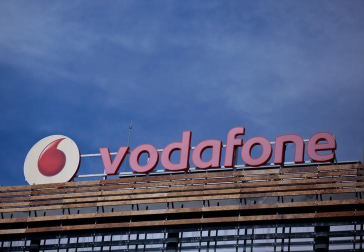 FILE PHOTO: The Vodafone logo can be seen on top of a building outside Madrid, Spain, April 13, 2016. REUTERS/Andrea Comas/File Photo
