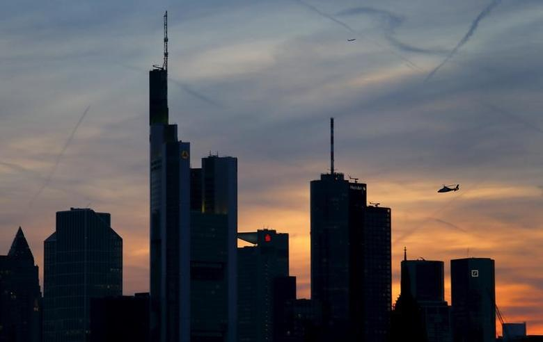 The famous skyline with its banking district is pictured as a rescue helicopter flies by in Frankfurt early evening April 13, 2015. REUTERS/Kai Pfaffenbach