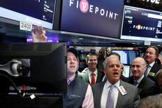Specialist trader Jay Woods (L) and Floor Governor Rudy Mass give a price for Five Point Holdings, LLC during the company's IPO on the floor of the New York Stock Exchange (NYSE) in New York, U.S., May 10, 2017. REUTERS/Brendan McDermid - RTS161PV