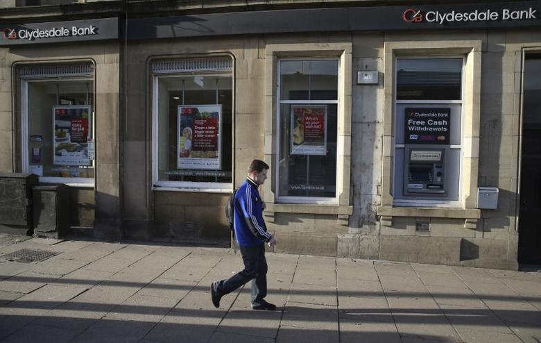 A man walks past a Clydesdale Bank in Edinburgh, Scotland, Britain February 3, 2016.  REUTERS/Russell Cheyne