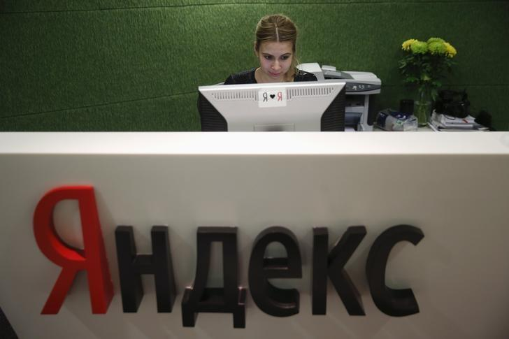 An employee works at Yandex headquarters in Moscow December 2, 2014. REUTERS/Maxim Zmeyev/Files