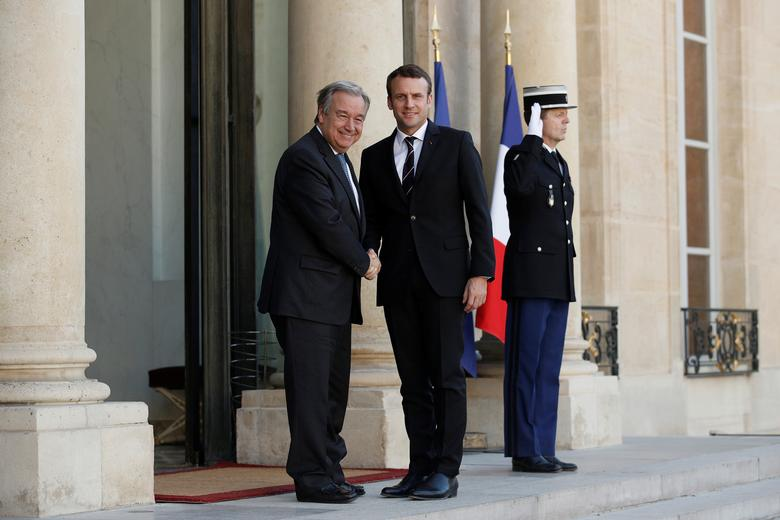 French President Emmanuel Macron greets U.N. Secretary General Antonio Guterres (L) prior their meeting at the Elysee Palace in Paris, France, May 16, 2017.  REUTERS/Yoan Valat/Pool