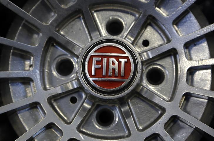 A Fiat logo is seen on the wheel of a Fiat car in Turin in this picture taken February 10, 2013. REUTERS/Stefano Rellandini/Files