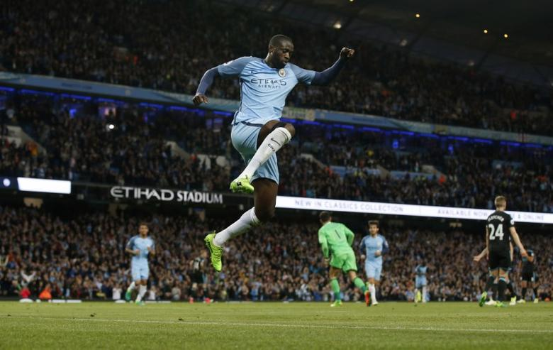 Britain Football Soccer - Manchester City v West Bromwich Albion - Premier League - Etihad Stadium - 16/5/17 Manchester City's Yaya Toure celebrates scoring their third goal Reuters / Andrew Yates