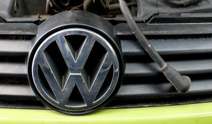 A Volkswagen (VW) logo is seen on a car's front at a scrapyard in Fuerstenfeldbruck, Germany, May 21, 2016.    REUTERS/Michaela Rehle/File Photo