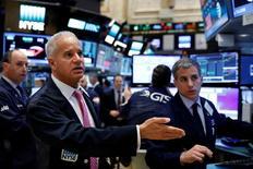 Traders work on the floor of the New York Stock Exchange (NYSE) in New York, U.S., May 15, 2017. REUTERS/Brendan McDermid
