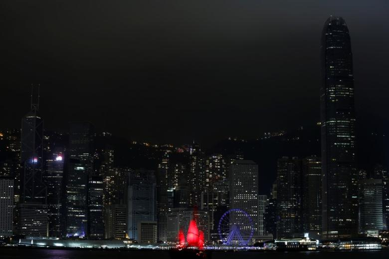 A tourist junk sails past as most of the lights in buildings in the financial Central District are switched off during Earth Hour in Hong Kong, China March 25, 2017.  REUTERS/Bobby Yip