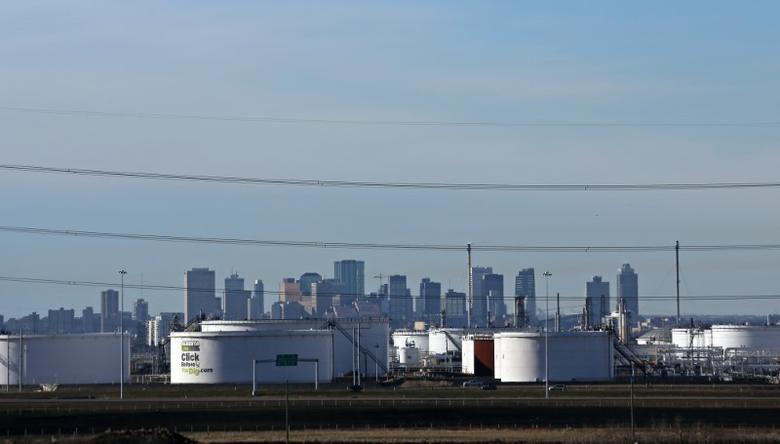 FILE PHOTO: Crude oil storage tanks at Enbridge's facility in Sherwood Park are seen against the skyline of Edmonton, Alberta, Canada November 13, 2016. REUTERS/Chris Helgren