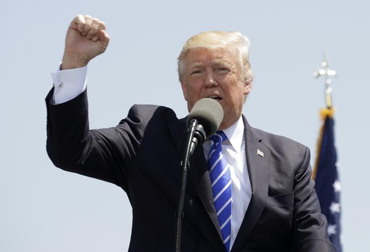 President Donald Trump pumps his fist as he addresses the graduating class of the U.S. Coast Guard Academy during commencement ceremonies in New London, Connecticut, U.S. May 17, 2017. REUTERS/Kevin Lamarque
