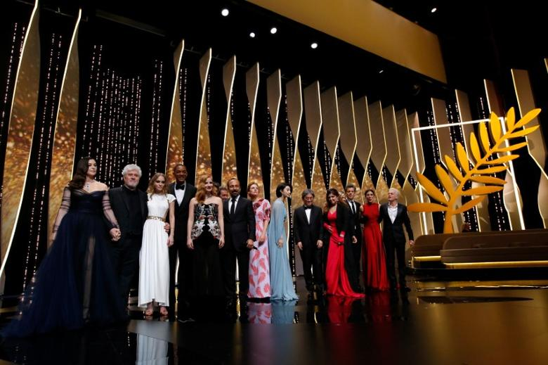 70th Cannes Film Festival - Opening ceremony and screening of the film ''Les fantomes d'Ismael'' (Ismael's Ghosts) out of competition - Cannes, France. 17/05/2017. Mistress of Ceremony actress Monica Bellucci, Director Pedro Almodovar, Jury President of the 70th Cannes Film Festival,  Director Asghar Farhadi and actress Lily-Rose Depp, and jury members Maren Ade, Jessica Chastain, Fan Bingbing, Agnes Jaoui, Park Chan-wook, Will Smith, Paolo Sorrentino and Gabriel Yared and actor Alex Lutz pose on stage. REUTERS/Stephane Mahe
