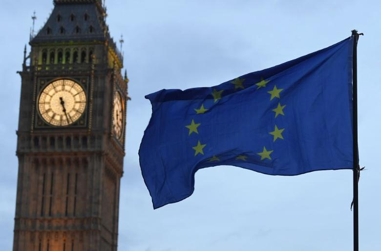 FILE PHOTO: A European Union flag is waved in front of Big Ben and the Houses of Parliament in London, Britain, February 20, 2017. REUTERS/Toby Melville