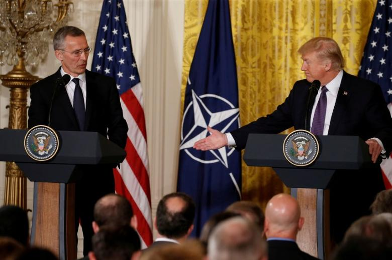 FILE PHOTO: U.S.  President Donald Trump (R) and NATO Secretary General Jens Stoltenberg hold a joint news conference in the East Room at the White House in Washington, U.S., April 12, 2017. REUTERS/Jonathan Ernst/File Photo