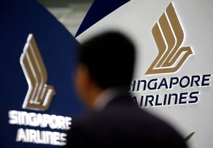 A man walks past a Singapore Airlines signage at Changi Airport in Singapore May 11, 2016. REUTERS/Edgar Su/Files
