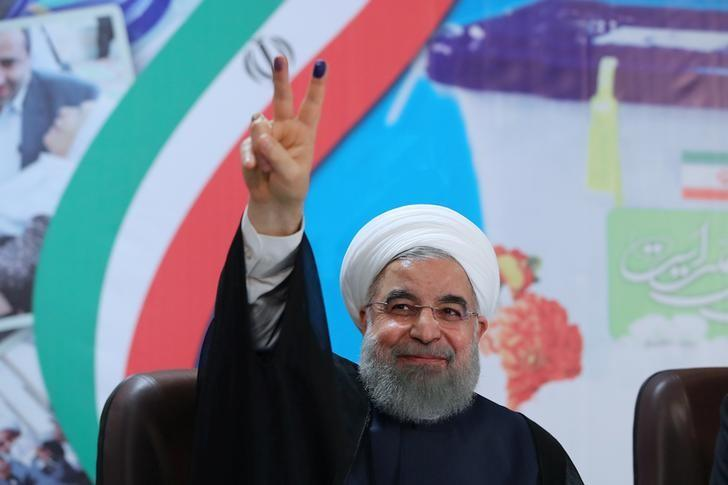 Iran's President Hassan Rouhani gestures as he registers to run for a second four-year term in the May election, in Tehran, Iran, April 14, 2017. President.ir/Handout/File Photo via REUTERS