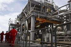 Oil workers walk through pipe installations on a tanker at Bonga off-shore oil field outside Lagos,  file.