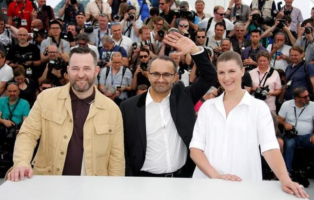 70th Cannes Film Festival - Photocall for the film ''Nelyubov'' (Loveless) in competition - Cannes, France. 18/05/2017. Director Andrey Zvyagintsev and cast members Maryana Spivak and Alexei Rozin pose. REUTERS/Jean-Paul Pelissier