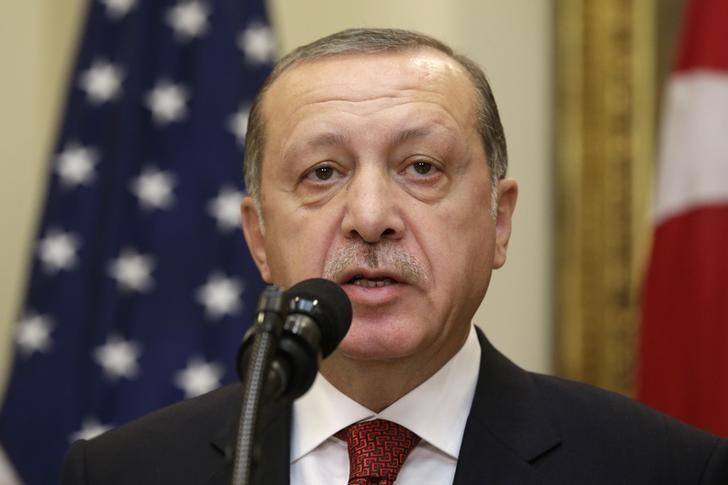 Turkey's President Recep Tayyip Erdogan delivers a statement to reporters alongside U.S President Donald Trump after their meeting at the White House in Washington, U.S. May 16, 2017. REUTERS/Kevin Lamarque