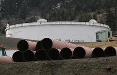 Replacement pipe is stored near crude oil storage tanks at Kinder Morgan's Trans Mountain Pipeline terminal in Kamloops, British Columbia, Canada November 15, 2016.   REUTERS/Chris Helgren