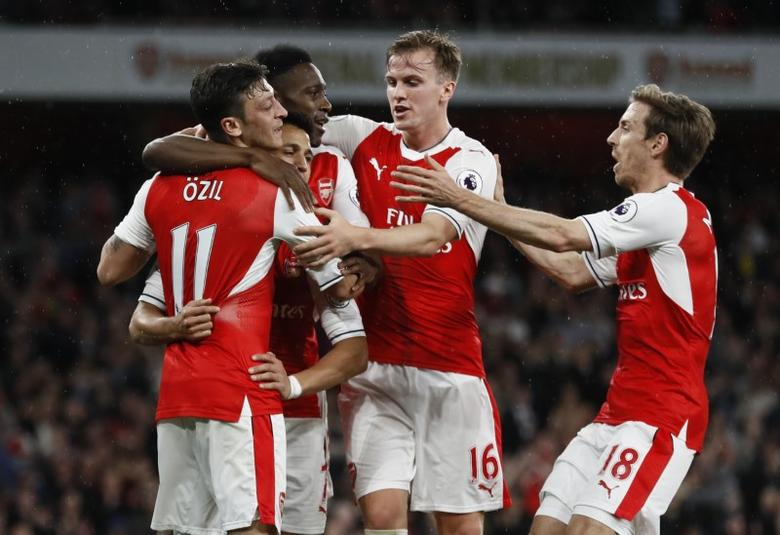 Britain Football Soccer - Arsenal v Sunderland - Premier League - Emirates Stadium - 16/5/17 Arsenal's Alexis Sanchez celebrates scoring their first goal with teammates Reuters / Stefan Wermuth