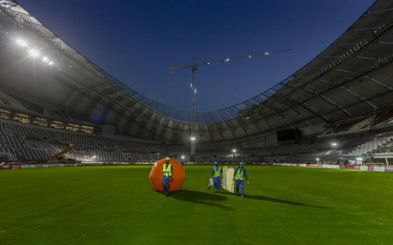 FILE PHOTO: Construction workers are seen at Khalifa International Stadium in Doha in this undated handout photo. Qatar's Supreme Committee for Delivery & Legacy/Handout/File Photo via REUTERS