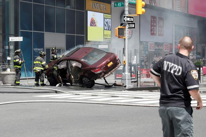 A vehicle that struck pedestrians and later crashed is seen on the sidewalk in Times Square in New York City, May 18, 2017. REUTERS/Mike Segar