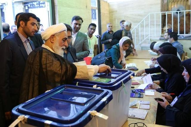 Ali Akbar Nategh-Nouri casts his vote into a ballot box during the presidential election in Tehran, Iran, May 19, 2017. TIMA via REUTERS