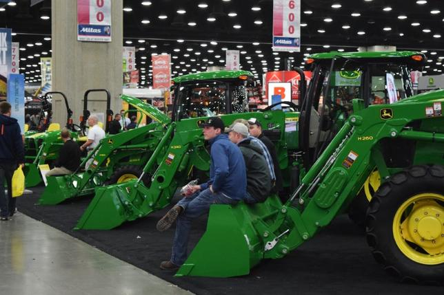 FILE PHOTO: People look at Deere equipment as they attend National Farm Machinery show in Louisville, Kentucky, February 11, 2016. REUTERS/Meredith Davis