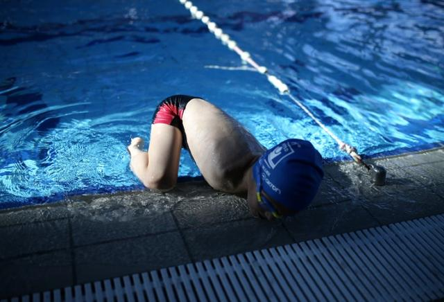 Ismail Zulfic, 6-year old armless swimmer exits from the pool in Olympic Pool Otoka in Sarajevo, May 18, 2017. Picture taken May 18, 2017. REUTERS/Dado Ruvic