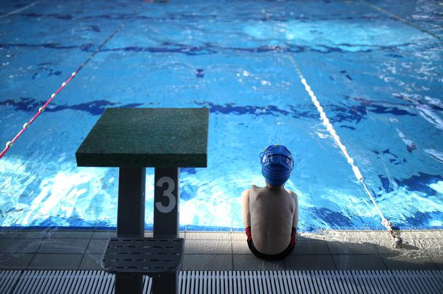 Ismail Zulfic, 6-year old armless swimmer sits by the pool in Olympic Pool Otoka in Sarajevo, May 18, 2017. Picture taken May 18, 2017. REUTERS/Dado Ruvic