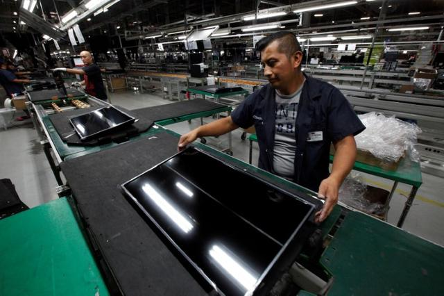 FILE PHOTO: An employee works at an LED TV assembly line at a factory that exports to the U.S. in Ciudad Juarez, Mexico, September 21, 2016. Picture taken September 21, 2016. REUTERS/Jose Luis Gonzalez/File photo