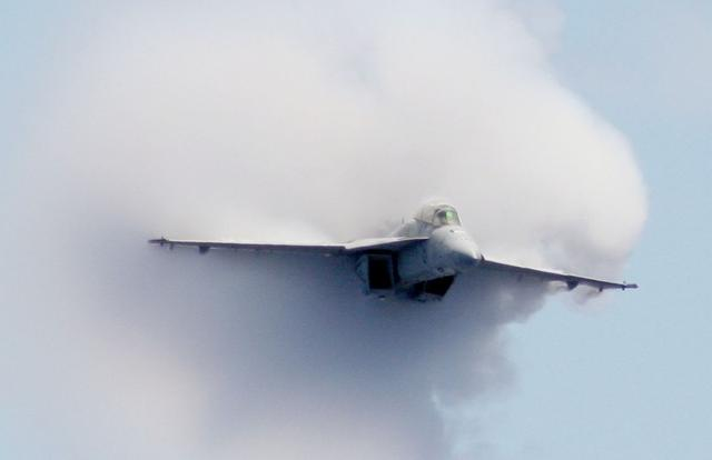 FILE PHOTO: Captain Norbert ''Smurf'' Szarleta, commanding officer of Carrier Air Wing 17, breaks the sound barrier in an F/A-18F Super Hornet strike fighter during an air power demonstration aboard the aircraft carrier USS George Washington on April 17, 2008.  U.S. Navy/Chief Petty Officer Augustine Cooper/Handout via REUTERS/File Photo
