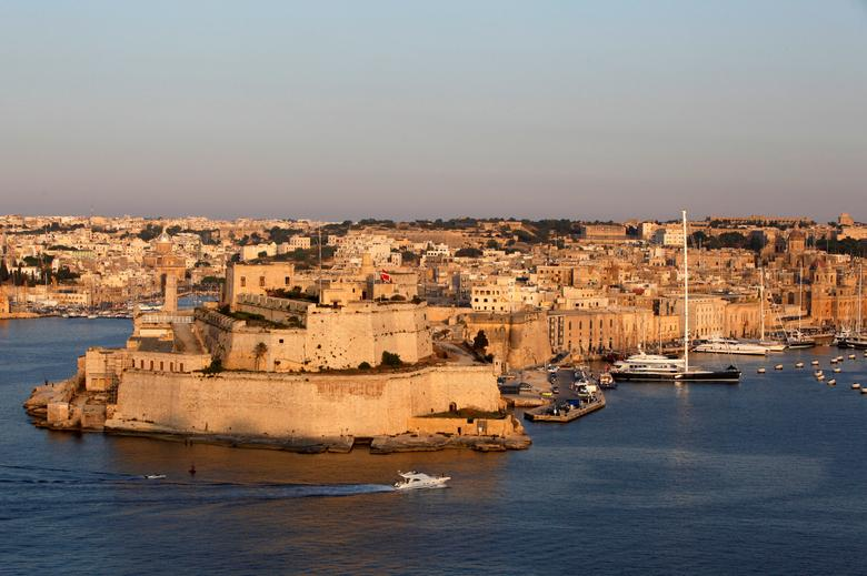 FILE PHOTO: A boat sails past the medieval Fort Saint Angelo in Vittoriosa, in Valletta