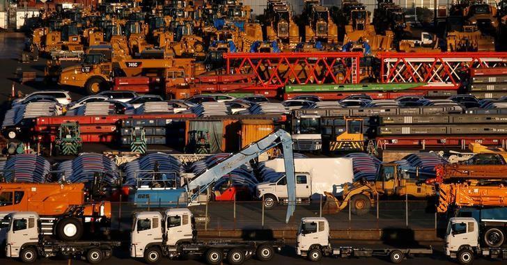 Newly manufactured vehicles await export at a port in Yokohama, Japan, January 16, 2017. Picture taken January 16, 2017.    REUTERS/Toru Hanai