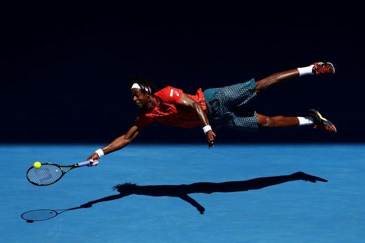 Gael Monfils of France dives for a forehand in his fourth round match against Andrey Kuznetsov of Russia, during the 2016 Australian Open at Melbourne Park, Australia, on 25 January 2016. Cameron Spencer, Getty Images/Courtesy of World Press Photo Foundation/Handout via REUTERS/Files