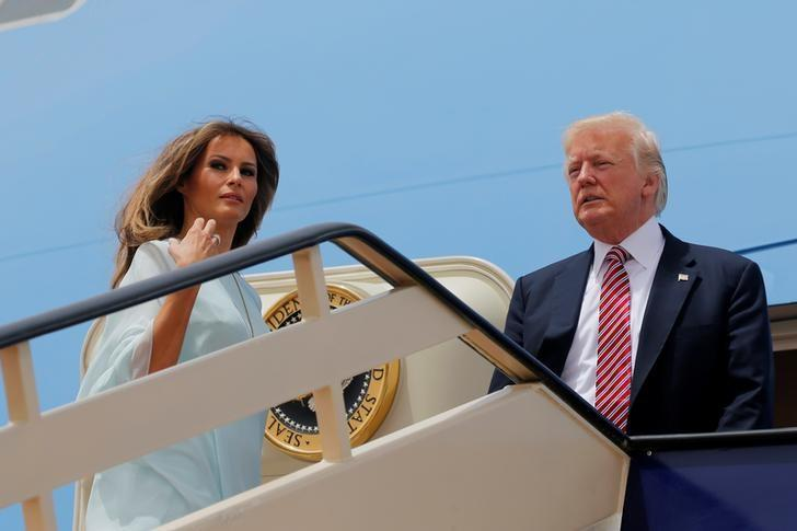 U.S. President Donald Trump and first lady Melania Trump board Air Force One to depart for Israel from King Khalid International Airport in Riyadh, Saudi Arabia May 22, 2017.  REUTERS/Jonathan Ernst