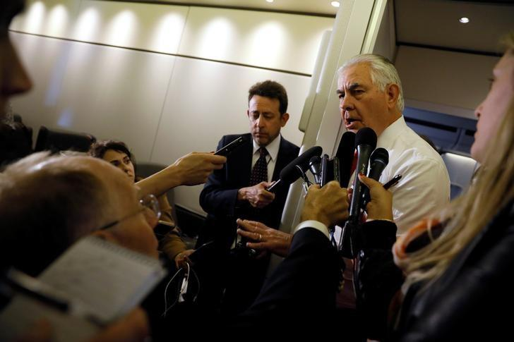 U.S. Secretary of State Rex Tillerson speaks with reporters after departing Saudi Arabia en route to Israel with U.S. President Trump's delegation aboard Air Force One, May 22, 2017.  REUTERS/Jonathan Ernst