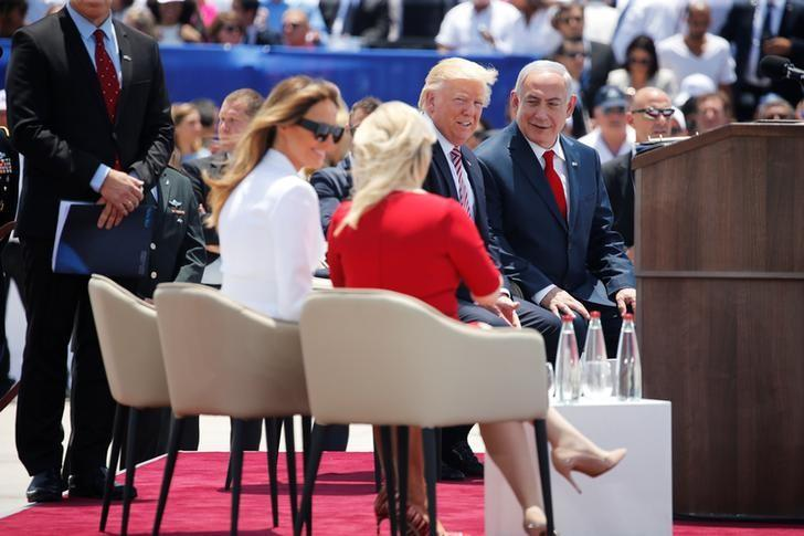 U.S. First Lady Melania Trump (seated, L) chats wife Sara Netanyahu (seated, front) as U.S. President Donald Trump (C) chats to Israel's Prime Minister Benjamin Netanyahu (R) during a welcoming ceremony to welcome Trump at Ben Gurion International Airport in Lod near Tel Aviv, Israel May 22, 2017. REUTERS/Jonathan Ernst