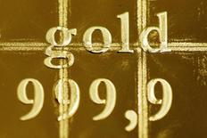 The writing of a gold Combibar is seen at a plant of gold refiner and bar manufacturer Valcambi SA in the southern Swiss town of Balerna December 20, 2012. The divisible gold combibar has a purity of 99.9 percent, weighs 50 grams and also has predetermined breaking points which allow it to be easily separated without any loss of material into 1 gram pieces. Picture taken December 20, 2012. To match story SWISS-GOLD/ REUTERS/Michael Buholzer (SWITZERLAND - Tags: BUSINESS)