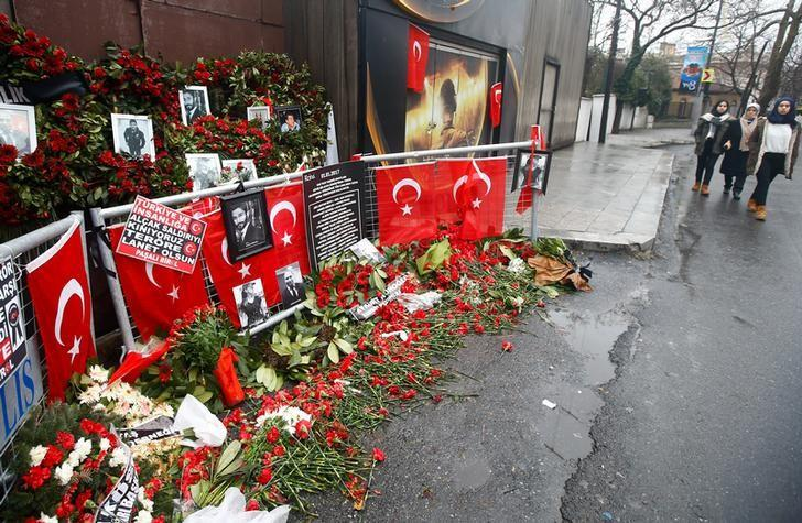 Flowers and pictures of the victims are placed near the entrance of Reina nightclub in Istanbul, Turkey, January 17, 2017. REUTERS/Osman Orsal/Files