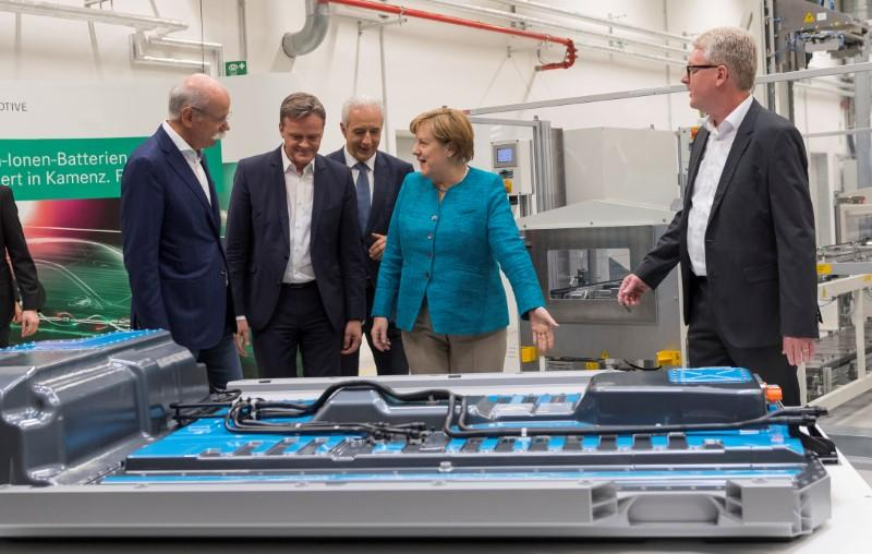 Germany must invest to keep up in electric cars: Merkel