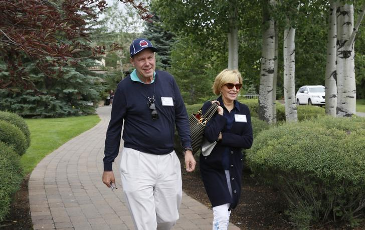 Michael Eisner, former Walt Disney CEO walks with Jane Eisner at the annual Allen and Co. conference in Sun Valley, Idaho Resort July 11, 2013.  REUTERS/Rick Wilking/Files