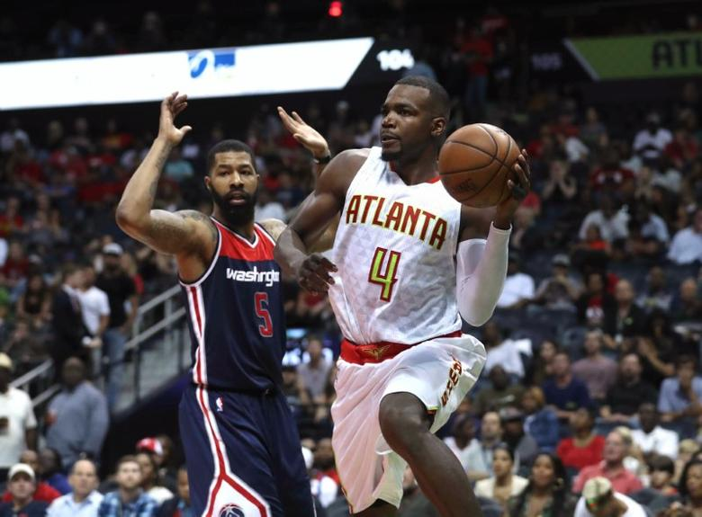 Apr 28, 2017; Atlanta, GA, USA; Atlanta Hawks forward Paul Millsap (4) passes away from the defense of Washington Wizards forward Markieff Morris (5) in the third quarter of game six of the first round of the 2017 NBA Playoffs at Philips Arena. Mandatory Credit: Jason Getz-USA TODAY Sports