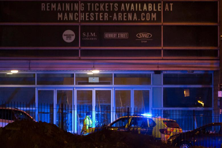 Police are seen outside the Manchester Arena in northern England where U.S. singer Ariana Grande had been performing in Manchester, Britain, May 22, 2017. REUTERS/Jon Super