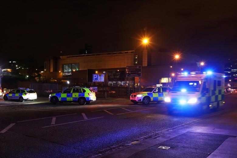 Police vehicles are seen outside the Manchester Arena, where U.S. singer Ariana Grande had been performing, in Manchester, northern England, Britain May 23, 2017. REUTERS/Jon Super
