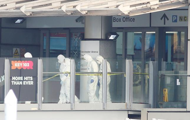 Forensics investigators work at the entrance to the Manchester Arena, Britain May 23, 2017. REUTERS/Andrew Yates